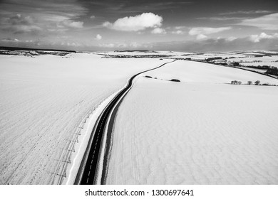 the road leading the winter landscape
