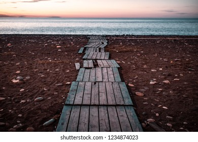 The road leads to the sea. Find your way and purpose in life. Road and way to the future and new discoveries. Freedom, success, start concept. Rest, travel and enjoy life