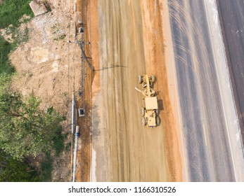 Road leveling equipment motor grader working at road construction site