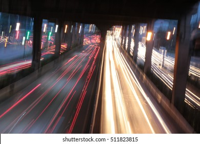 the road with light car of slow speed shotter in the city in night time, bangkok, Thailand