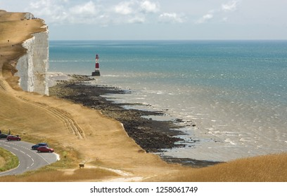 Road and lighthouse at Beachy Head near Eastbourne, East Sussex, England. With people.