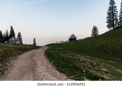 Road and little houses in mountains