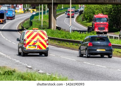 road maintenance van on uk motorway in fast motion.