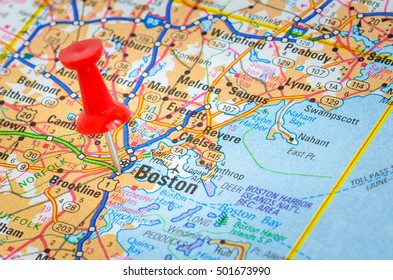 Road Map with the City of Boston Highlighted by a Red Pushpin. Shallow Depth of Field.
