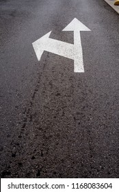 road marking arrow forward and left on road surface