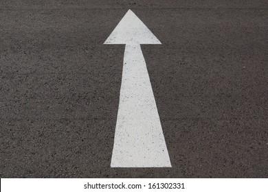 Road marking arrow on asphalt