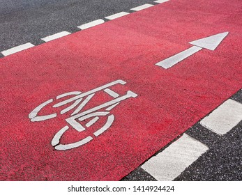 Road marking bicycle lane with arrow sign
