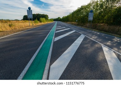 Road marking, green central reservation on country road