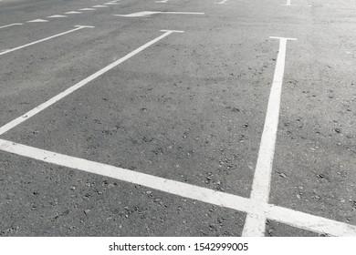 Road marking on asphalt with parking spots