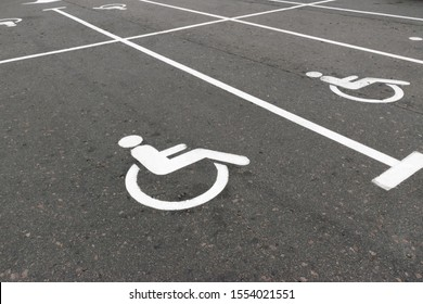 Road marking on the asphalt with parking spaces for the disabled