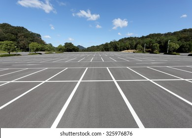 Road marking on the asphalted parking place