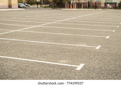 Road marking on the asphalted Parking lot without cars
