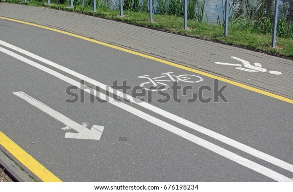 Road marking on a cycle track.