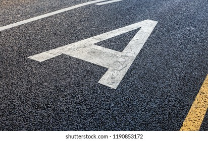 Road marking with the russian letter A, denoting a dedicated bus line