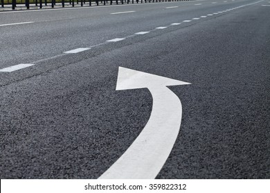 road marking in white paint on the pavement