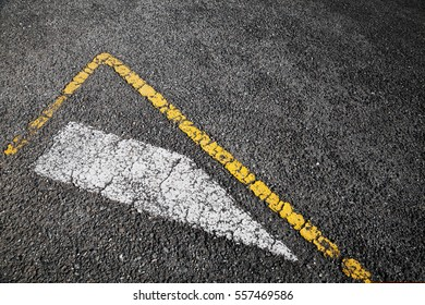 Road marking, white stripe and corner of yellow borders line over black asphalt pavement, background photo