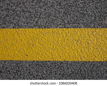 road marking yellow and asphalt