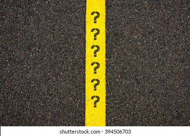 Road marking yellow paint dividing line with question marks, concept image