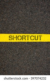 Road marking yellow paint dividing line with word SHORTCUT, concept image