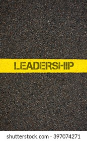 Road marking yellow paint dividing line with word LEADERSHIP, concept image