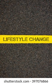 Road marking yellow paint dividing line with words LIFESTYLE CHANGE, concept image
