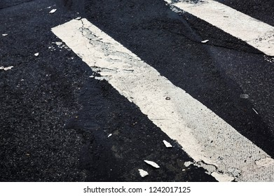 Road markings on asphalt on the street of Manhattan in New York City. Pedestrian crossing on the road in NYC