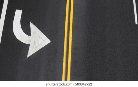 Road markings on asphalt on the street of Manhattan in New York City