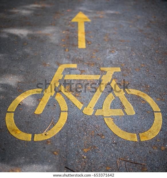 Road markings.Yellow bicycle symbol