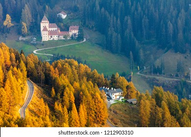 Road to a medieval castle in the Alps