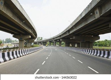 Road in the middle of overpasses, National Highway 8, New Delhi, India