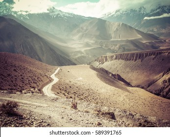 Road to the mountain in desert rural area, Annapurna, Nepal. Retro vintage style