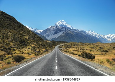 Road to Mountain in New Zealand Landscape. Travel and Adventure Landscape background. Beautiful scenic view of Mountains and road in South Island NZ. Mount Cook. Aoraki Mt Cook