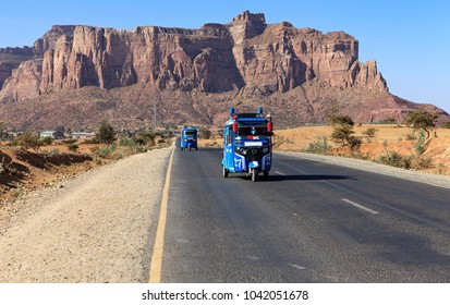 road and mountains in the background