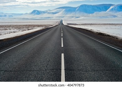 Road with mountains behind in Siberia