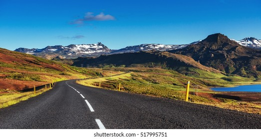 Road in mountains. Bridge over a channel connecting Jokulsarlon Lagoon and Atlantic Ocean in southern Iceland.