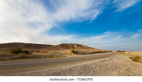 Road in a mountains in desert Negev at sunset