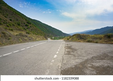 Road in mountains. Summer day. Horizontal shot