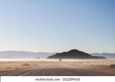 Road in the Namib desert in the morning mist, Namibia, Africa./Road in the Namib desert in the morning mist