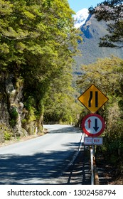 Road narrowing to one way across a bridge in Fjordland National Park, New Zealand