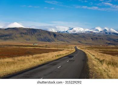 Road near Arnarstapi and volcanoes Stapafell in Snaefellsjokull, Iceland.