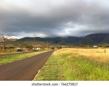 A road near Lahaina, with mountains off in the distance. Photo taken on Maui, Hawaii.