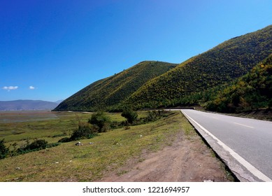 road near mountain and savanna