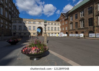 Road next to Christiansborg Slot (Christiansborg Palace), Copenhagen, Denmark - 23 Jun 2018: Christiansborg Slot is a palace and government building on the islet of Slotsholmen in central Copenhagen.