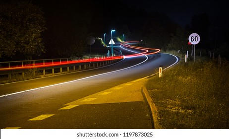 Road at night with car trail