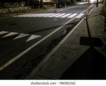 Road at night with crosswalk