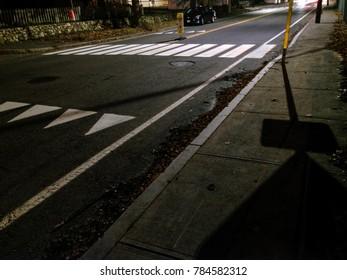 Road at night with crosswalk