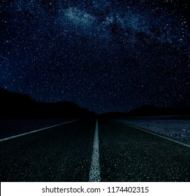 Road at night with a sky full of stars