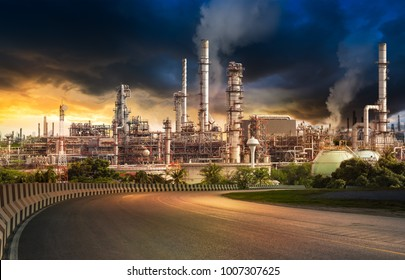 road to the oil refiner with motion blur rain cloud on sunset background