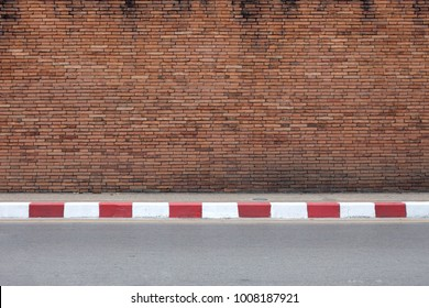 road and old red brick wall texture