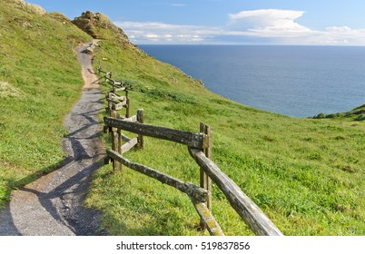 The road to the old wooden fence along the hills near the ocean